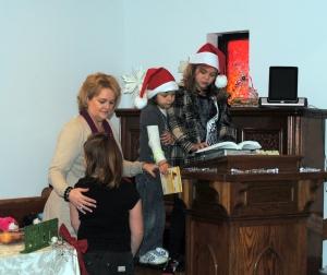 Kids at ElysJoy Reading the Christmas Story from Luke